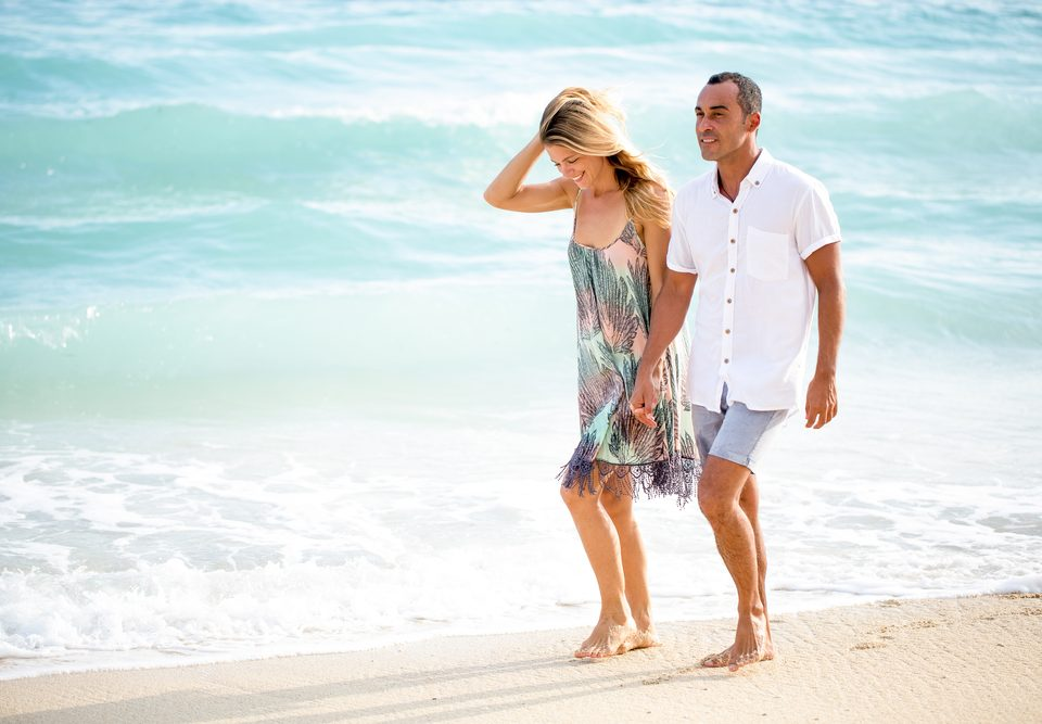couple walking down the beach